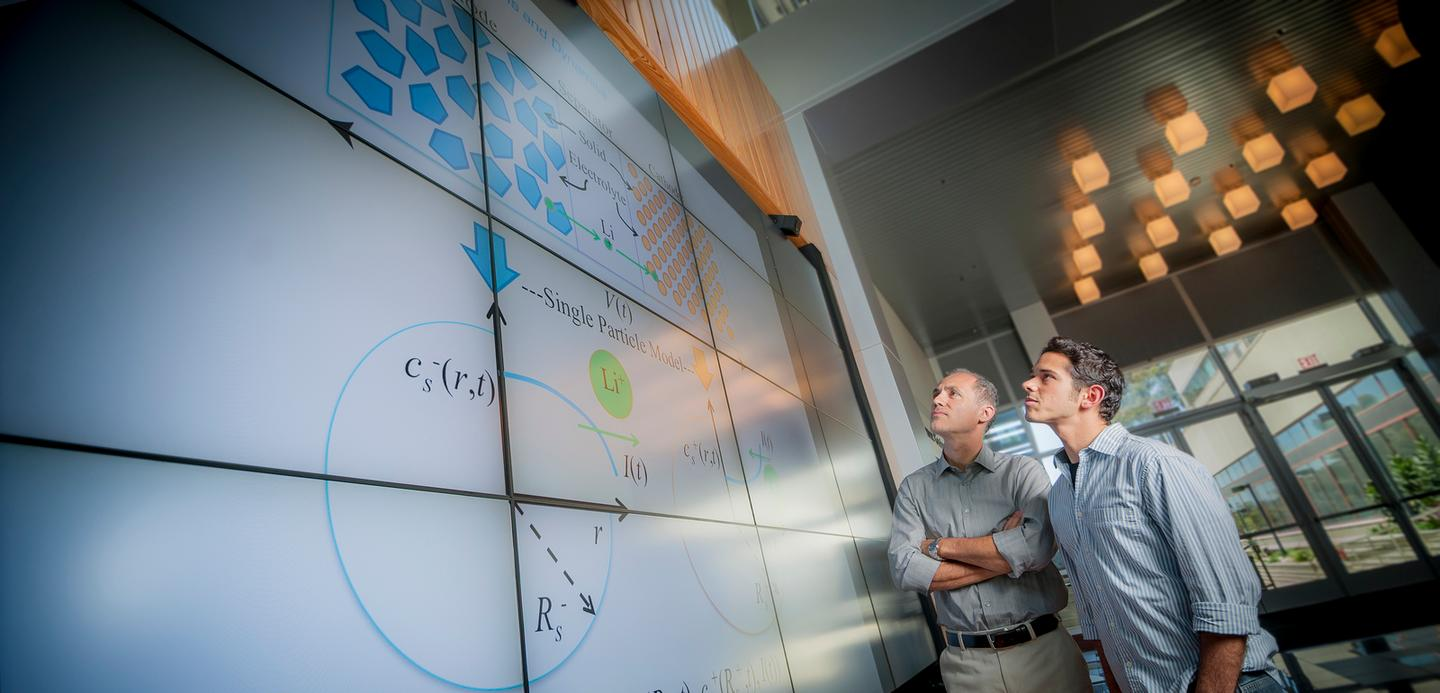 Miroslav Krstic (left) and UC President's Postdoctoral Fellow Scott Moura have developed estimation and control algorithms that improve the efficiency of lithium-ion batteries (Photo: Jacobs School of Engineering)