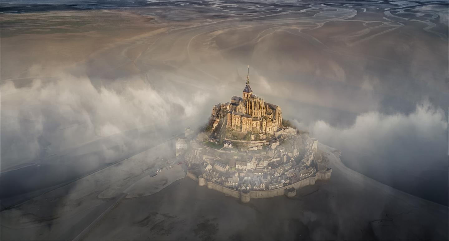 The grand prize winning photograph - the famous monastery of Mont Saint Michel during a foggy morning