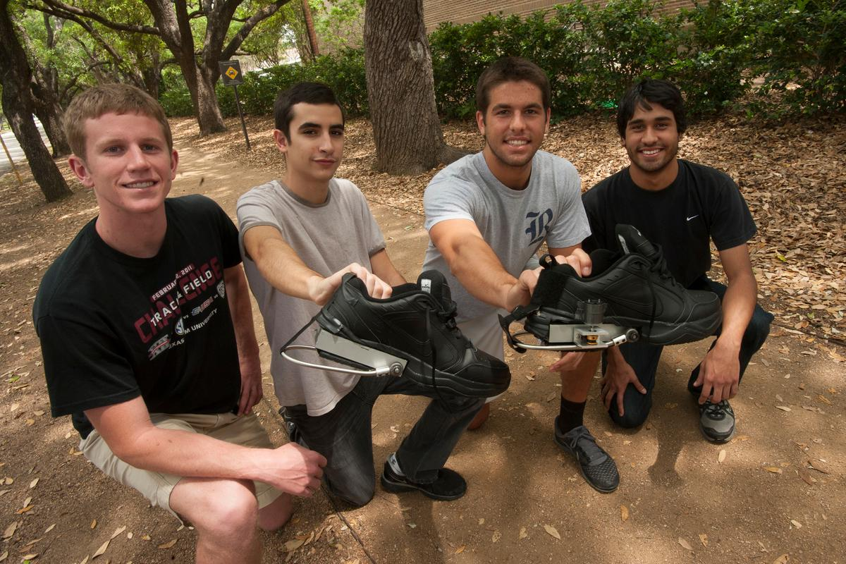 Rice University engineering students Tyler Wiest, Carlos Armada, Julian Castro and David Morilla with their PediPower prototypes (Photo: Jeff Fitlow)