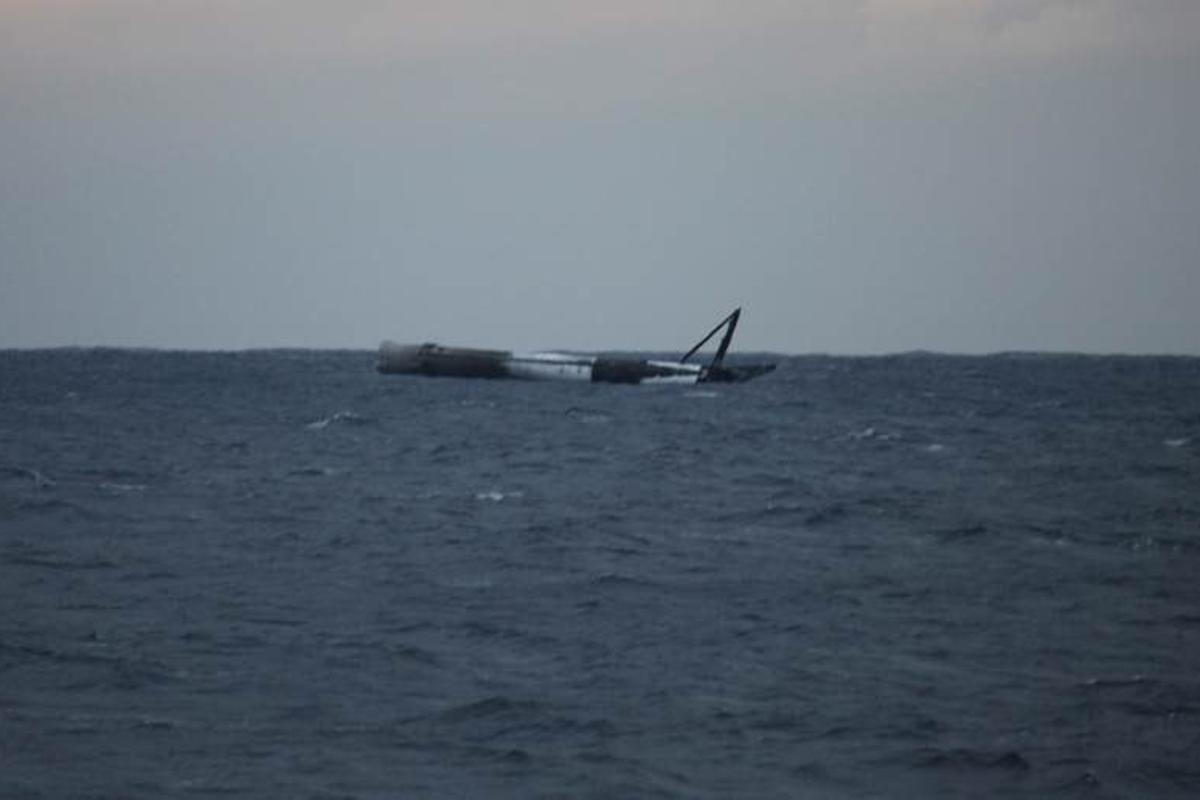 SpaceX's Falcon 9 rocket bobbles in the ocean, after surviving an experimental test landing