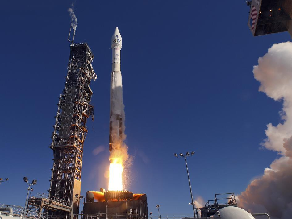 The LDCM spacecraft being lifted into orbit by an Atlas V rocket (Photo: NASA)