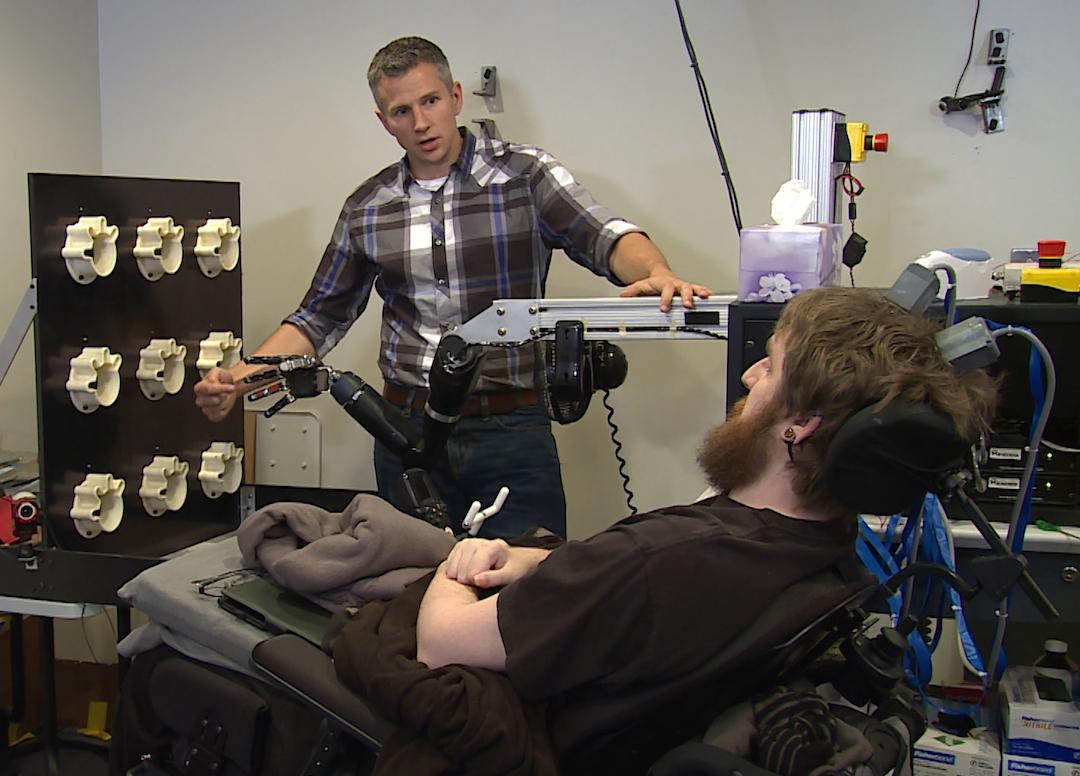 Nathan Copeland is able to control the robotic hand through the type of thought commands anyone would use to move their limbs