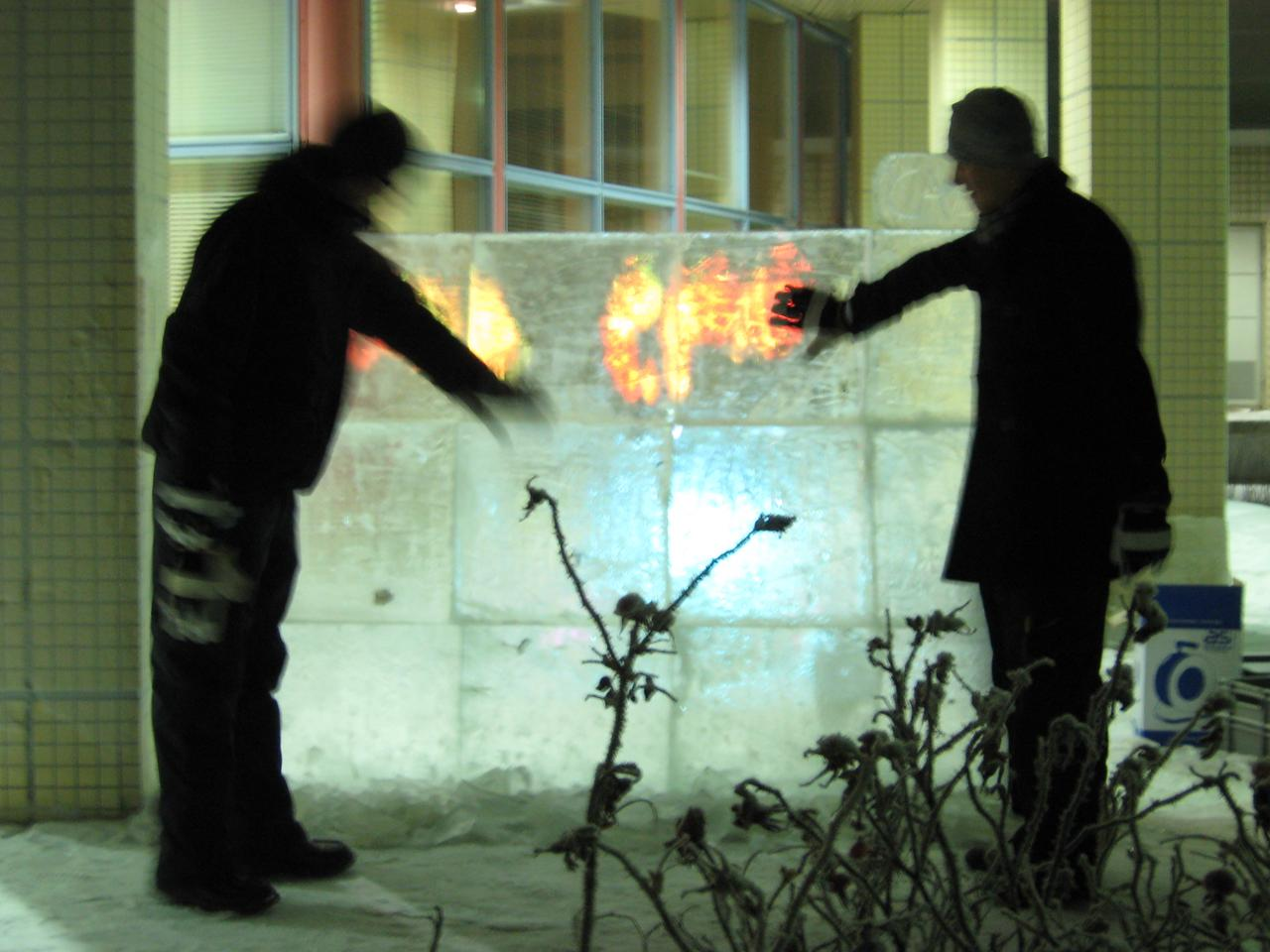 The hand movements of both gloved and ungloved users were tracked using rear-diffused illumination multi-touch tracking technology and an image of flames projected behind the moving hands in real-time