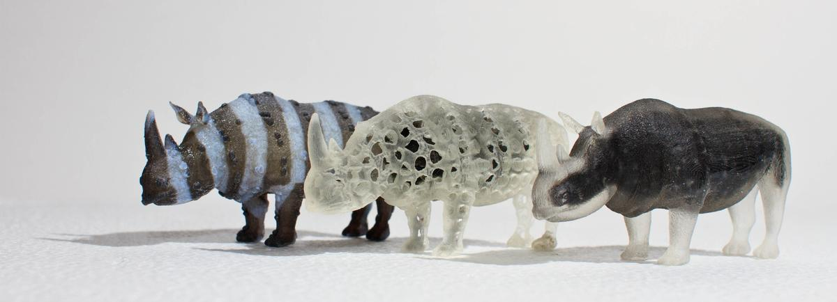 A zebra-like textured rhino with spiky skin, a porous rhino and an opaque rhino with a transparent shell 3D printed with a multi-material printer (Photo: MIT Computational Fabrication Group)