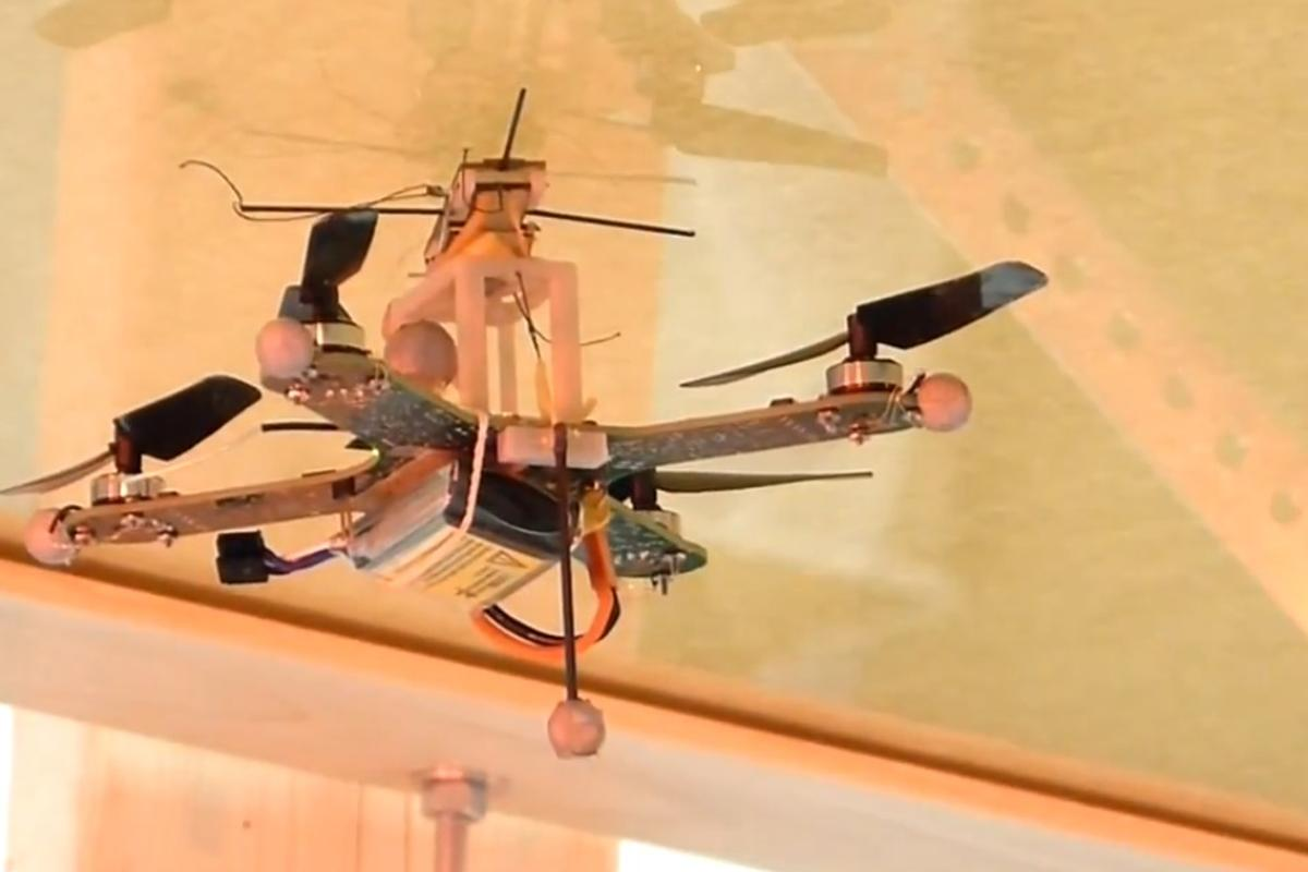 Researchers have developed a quadcopter that can attach to walls and ceilings with a dry adhesive before taking off again