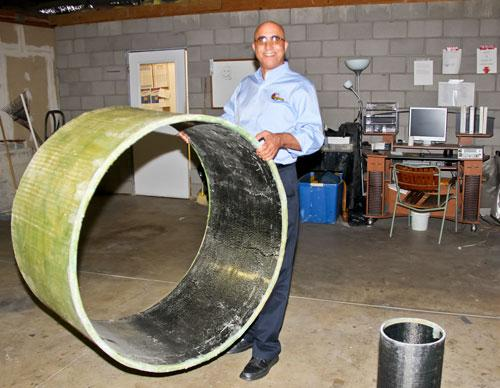Prof. Ehsani demonstrating the light weight of the pipe (Photo: University of Arizona)