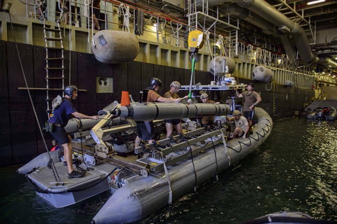 ExMCMCo load a Mk 18 Mod 2 UUV in the dock of RFA CARDIGAN BAY