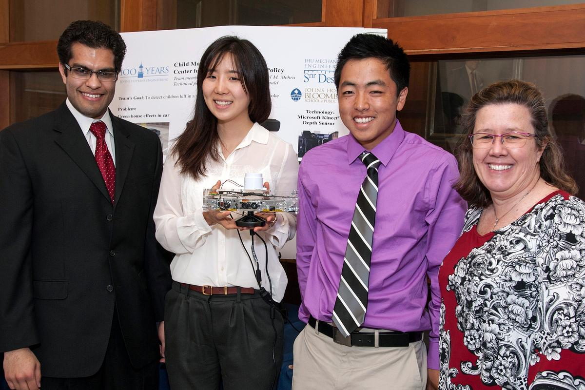 From left, students Anshul Mehra, Yejin Kim and Jeffrey Kamei, with their faculty sponsor Eileen McDonald (Photo: Norman Barker/homewoodphoto.jhu.edu)