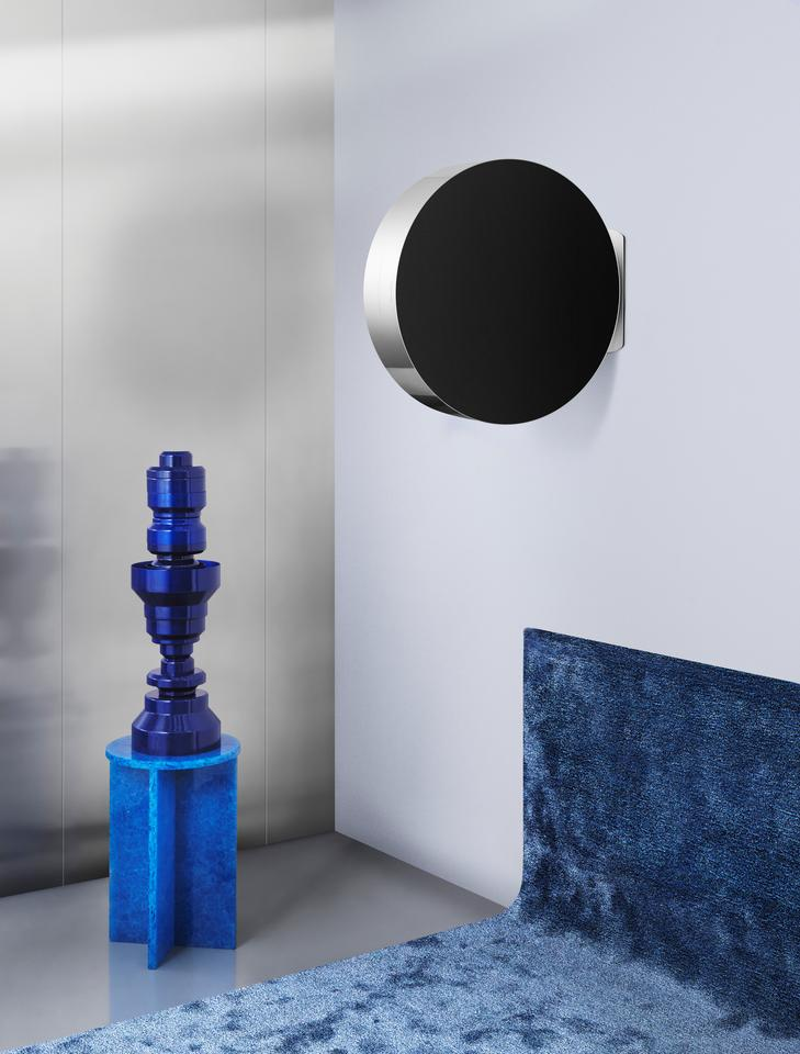 The Beosound Edge wireless speaker can be mounted on a living room wall, though with speakers firing on both sides it juts out precariously