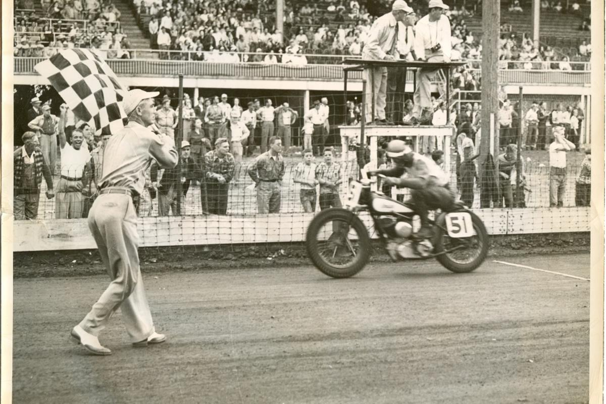 Bill Tuman crosses the line on the last Indian motorcycle to race flat track, until now
