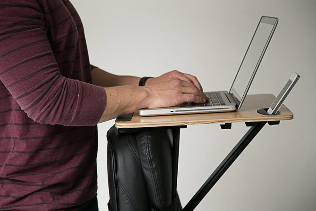 The StorkStand is simply strapped onto the back of an existing office chair