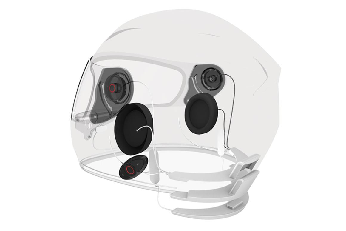 The Sena INC helmet is controlled by two buttons; the one on the left, above the ear cup powers on and off the INC system, while the right one controls the Ambient Mode. Lower on the left side is the Bluetooth connecting dock.