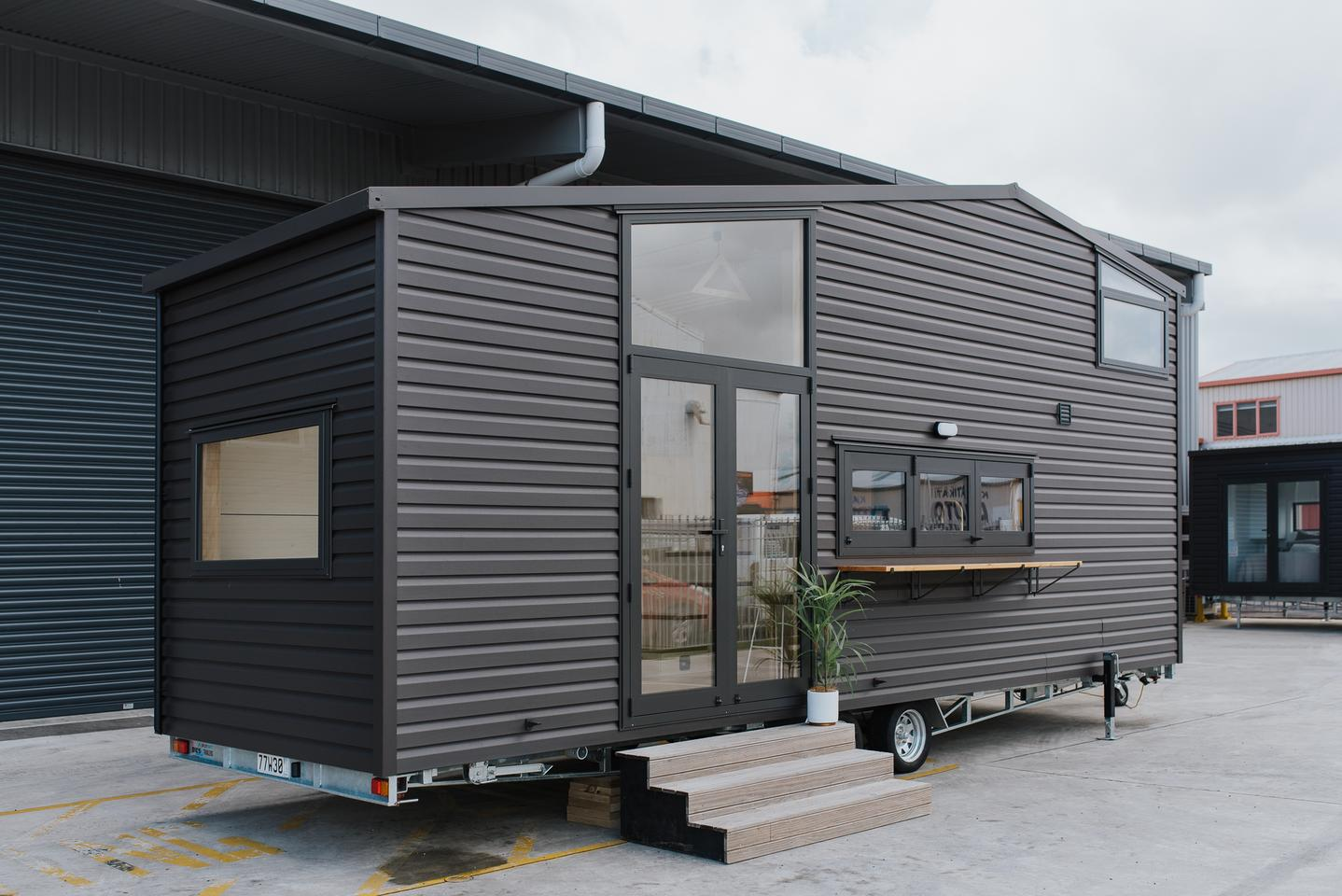 The Hilltop Tiny House features a steel frame and is finished in vinyl cladding