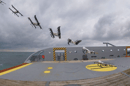 A composite photo of the drone taking off from a coastguard ship