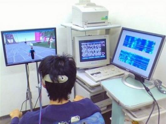 Japanese student walking in a virtual world with the character controled by his brain waves, in Yokohama, in 2007. Pic courtesy AFP/HO/File