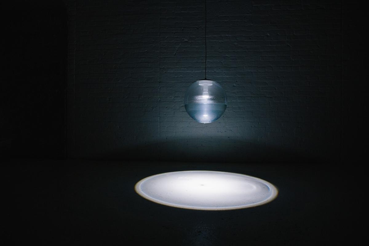 The Rain Lamp refracts light through a pool of water