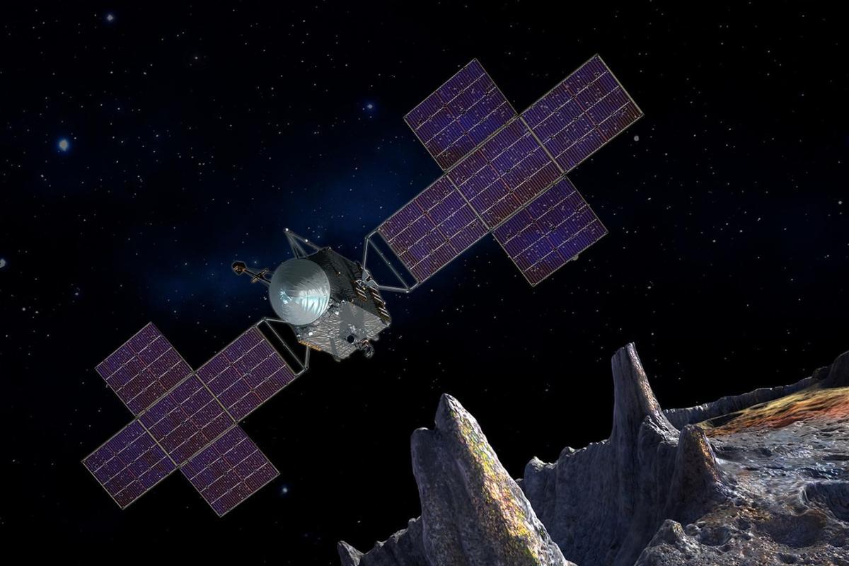 Artist's impression of NASA's Psyche spacecraft orbiting a metallic body