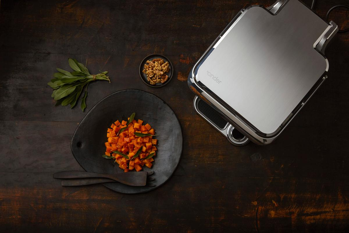 The Cinder Sensing Cooker brings precision temperature control to home grilling