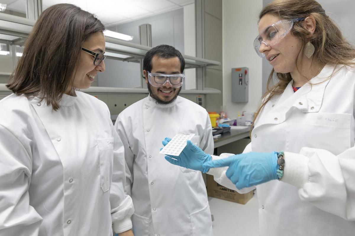 Sahika Inal, Shofarul Wustoni and Eloise Bihar (l-r) inspect a set of the inkjet-printed sensors