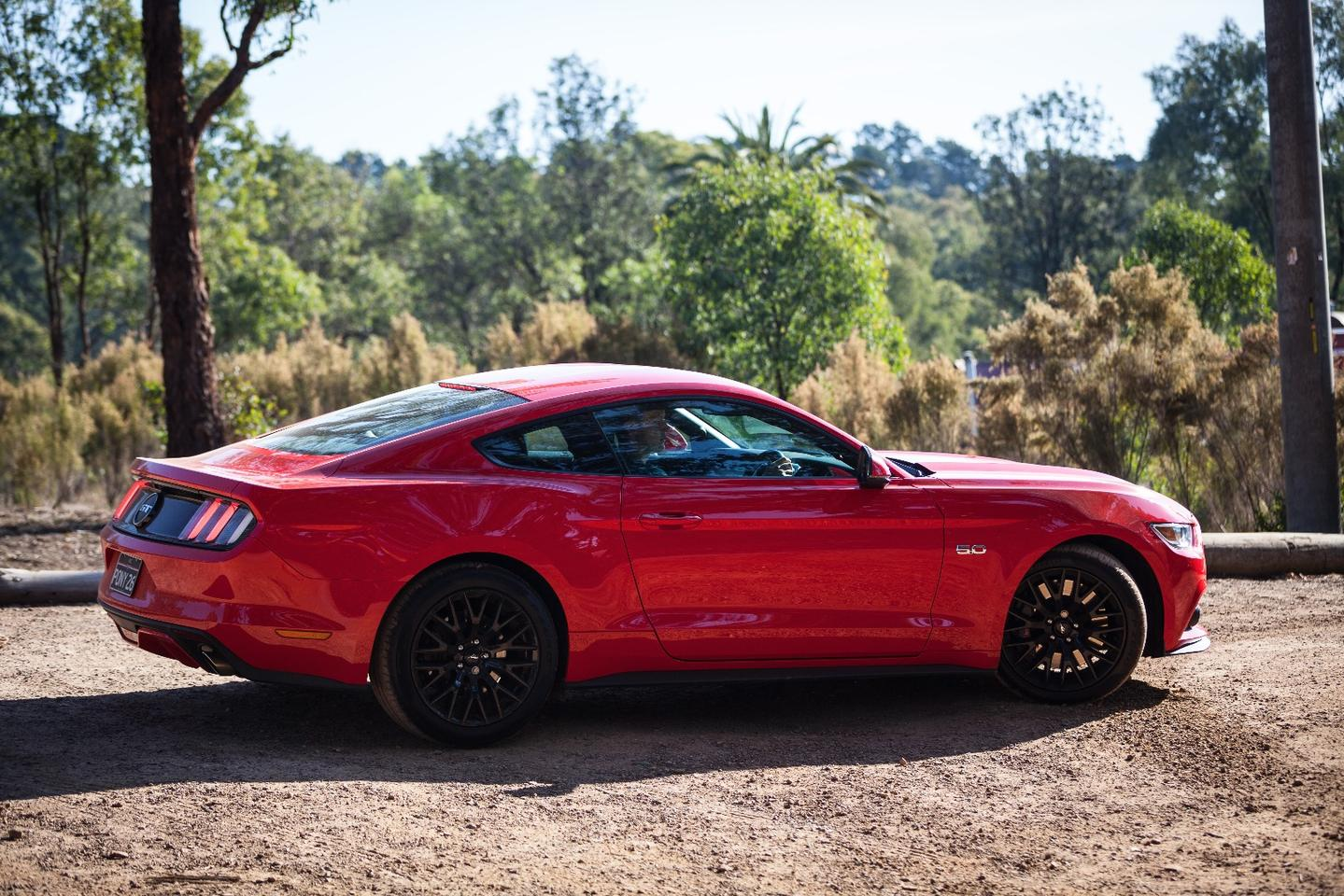 The 'Stang draws plenty of attention to itself, not least in our test car's Race Red finish