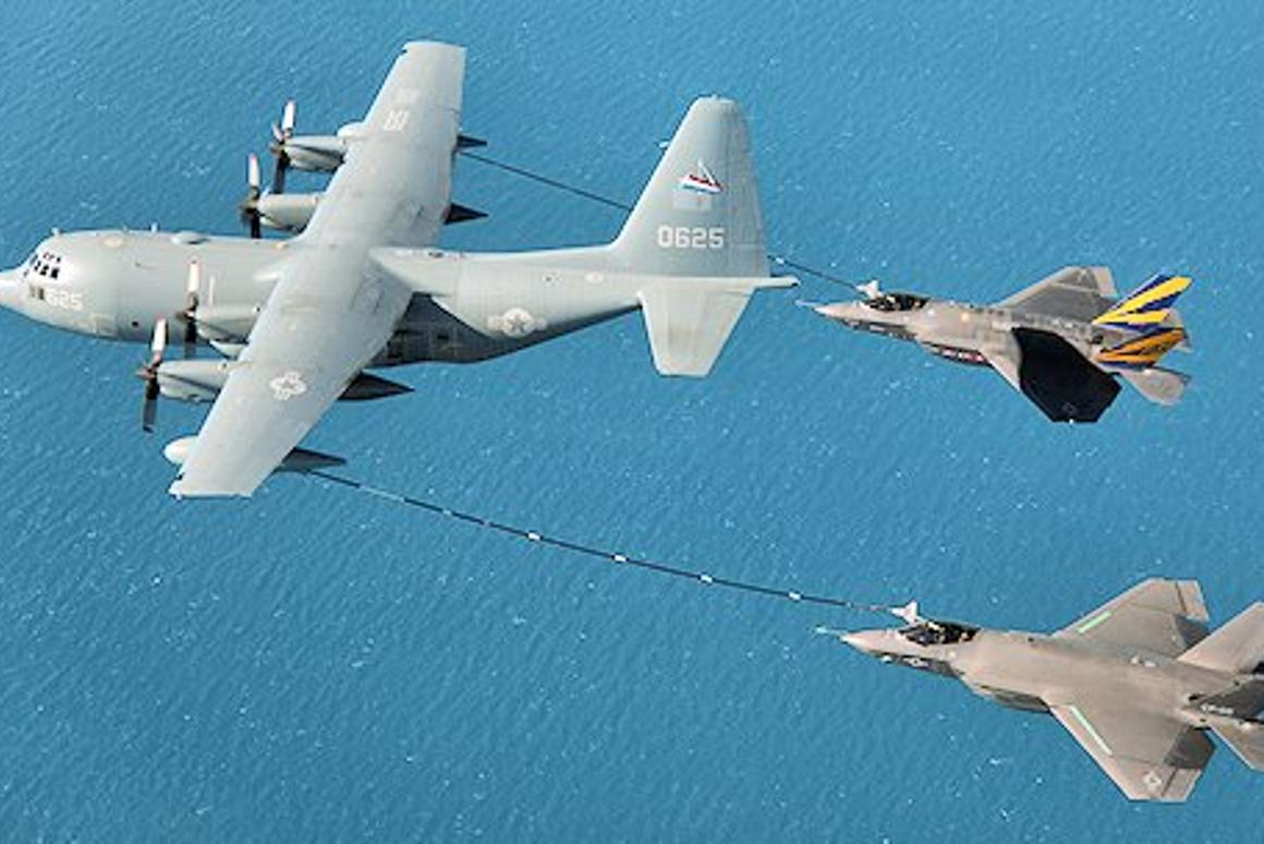 Two F-35C carrier variant fighters refuel from a single KC-130