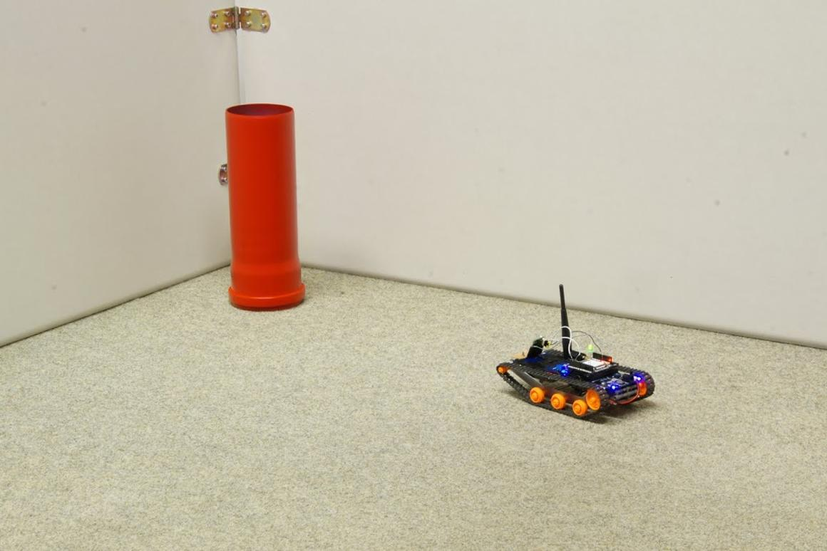 """The robot makes a bee-line for a red cylinder, after learning that """"red is good"""""""