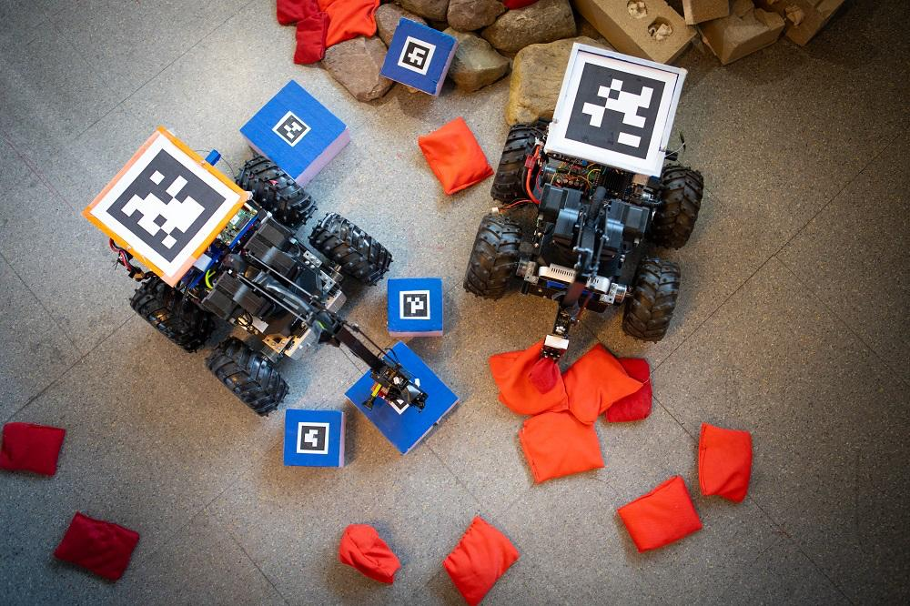 The bridge-building robot is said to take cues from its surrounding, picking up bean bags to fill in the gaps in the rubble until it can more easily move over the rocks, bricks and broken concrete to reach its goal