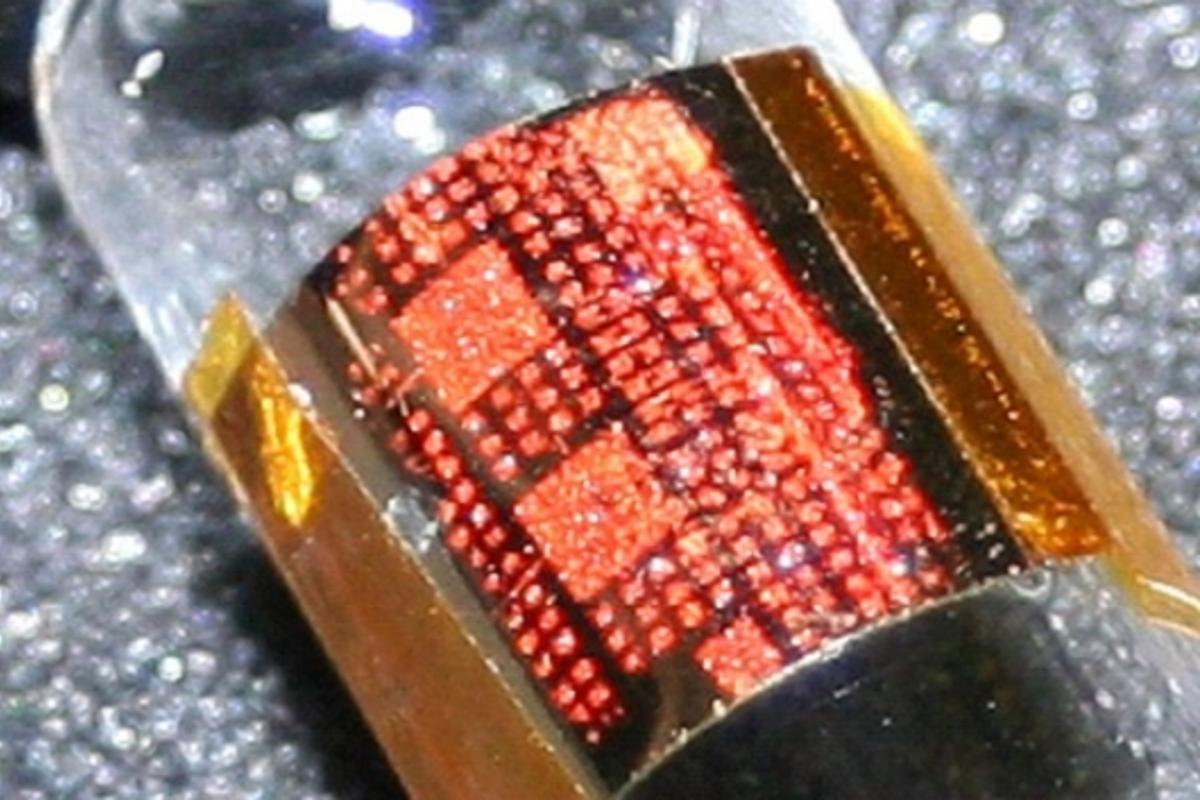 Flexible transistors arrays with organic crystal rubrene around a glass vial (Credit: Stanford University)