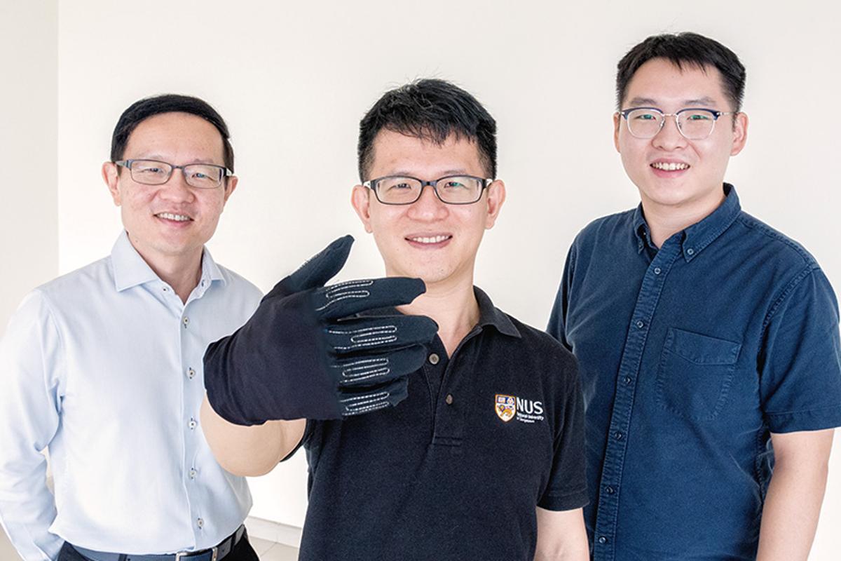 The InfinityGlove team, Prof. Lim Chwee Teck (left), Dr. Yeo Joo Chuan and Dr. Yu Longteng