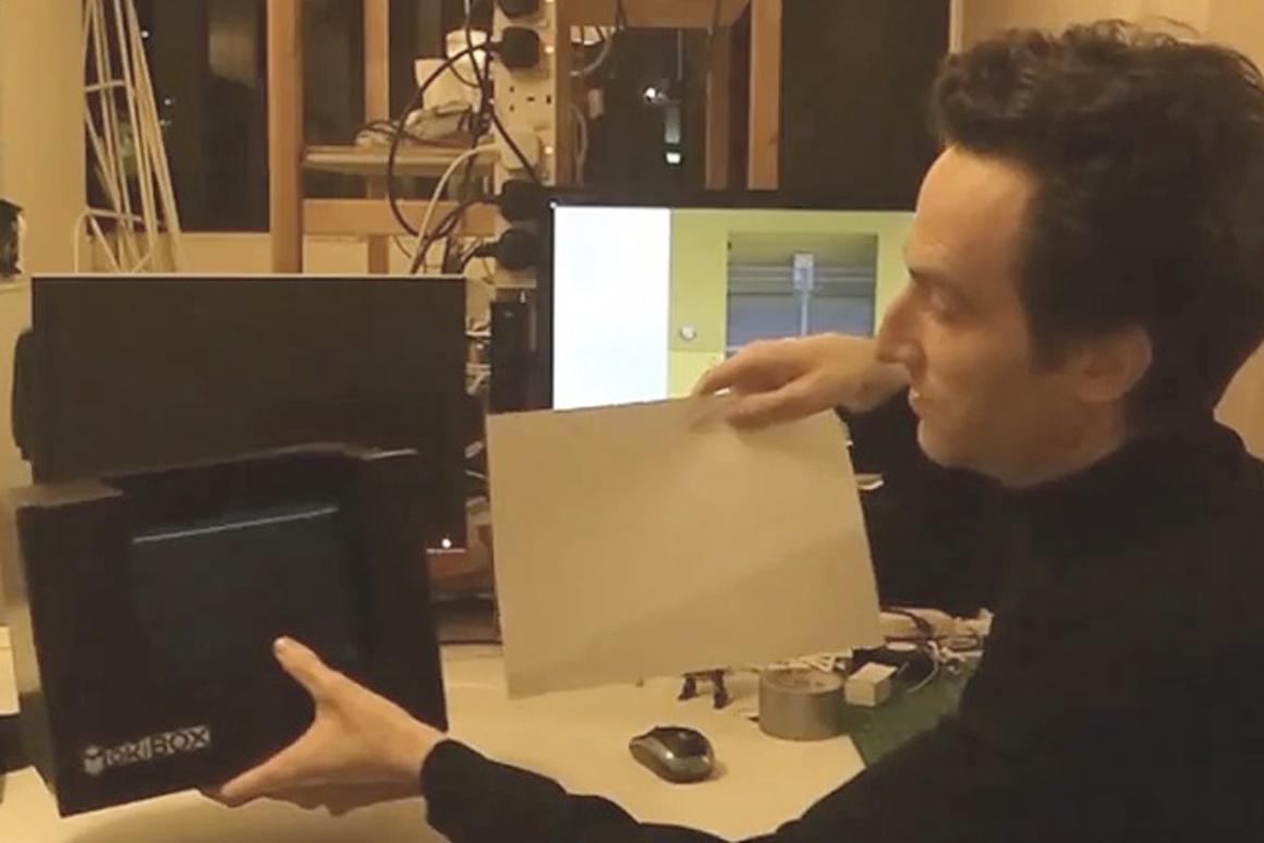 MakiBox designer Jon Buford shows off the 3D printer's compact size