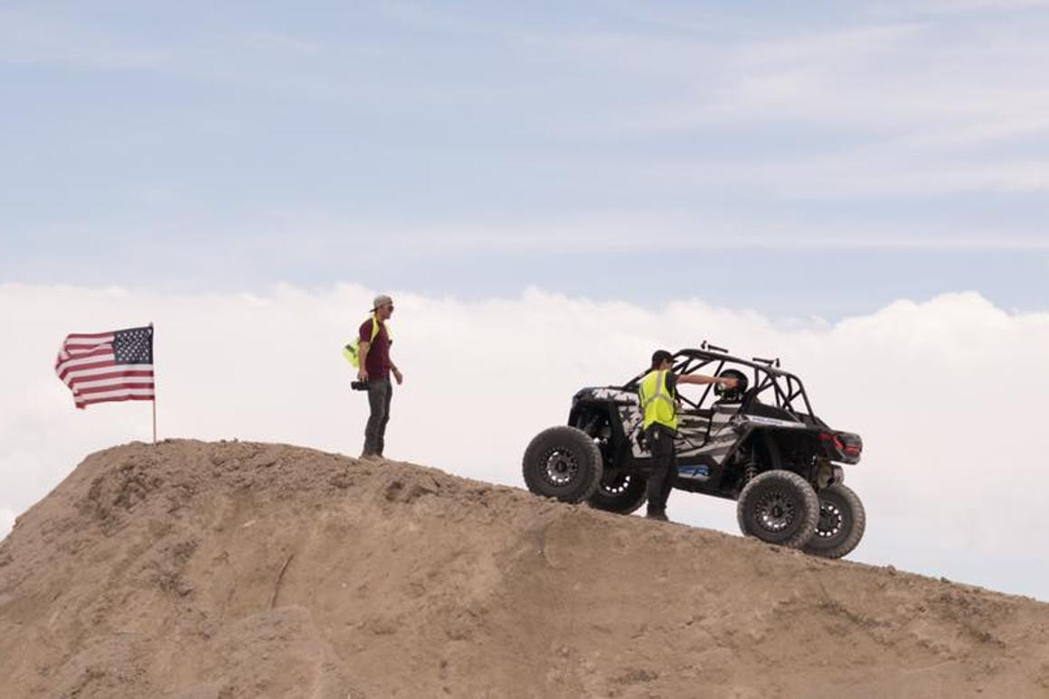 Godfrey prepares to break the world distance jumping record in a Polaris RZR
