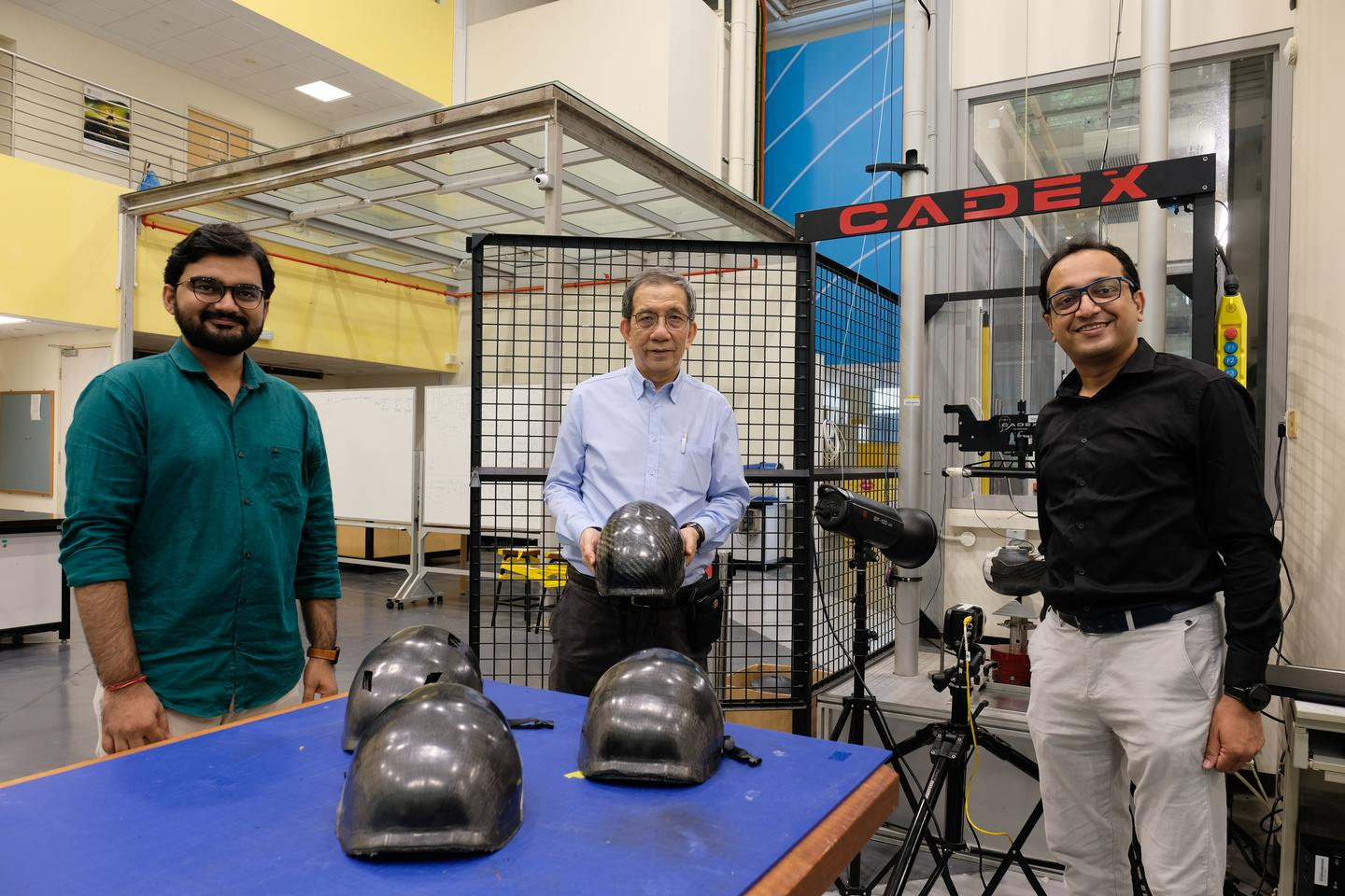 From left to right: Research associate Goram Gohel, Assoc. Prof. Leong Kah Fai and research fellow Dr. Bhudolia Somen Kumar, with some of their helmets