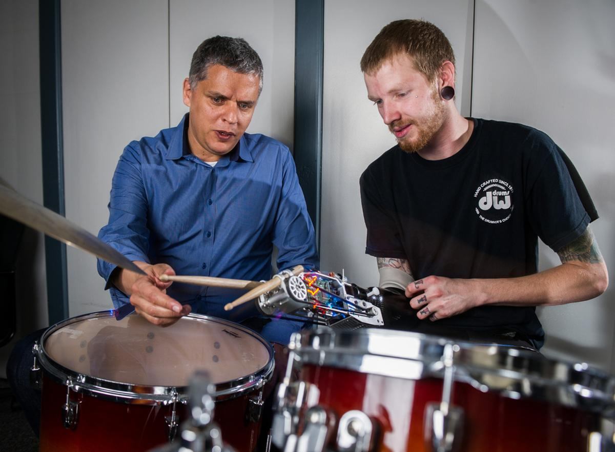 Jason Barnes and Professor Gil Weinberg demonstrate the robotic prosthesis