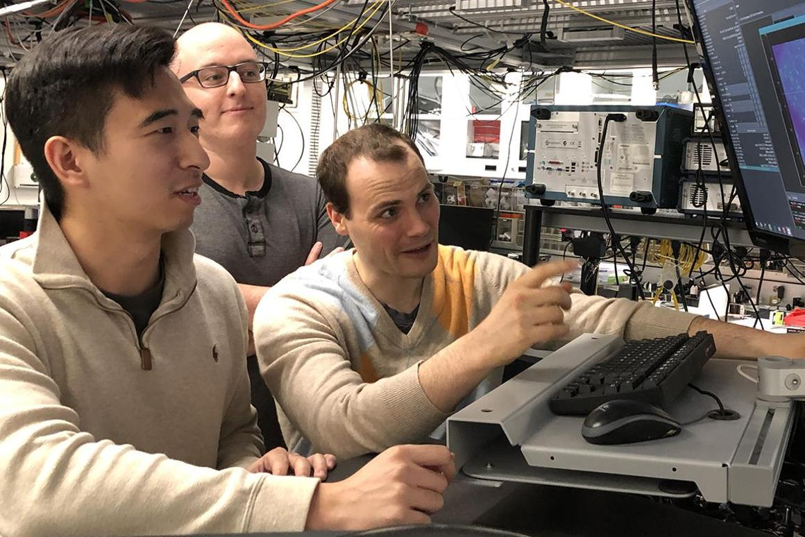 Graduate students Kevin Miao, Chris Anderson, and Alexandre Bourassa monitor quantum experiments at the Pritzker School of Molecular Engineering