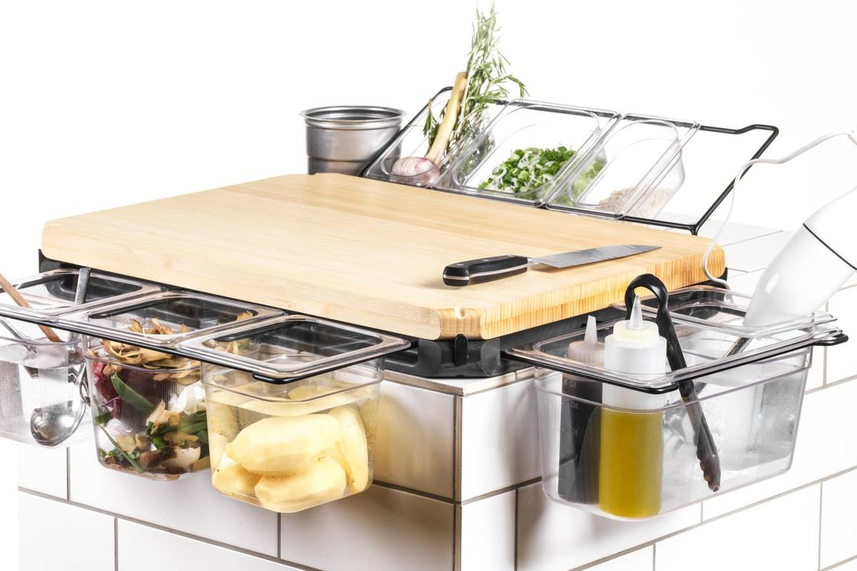 The Frankfurter Brett provides a means of storing chopped food, waste and utensils