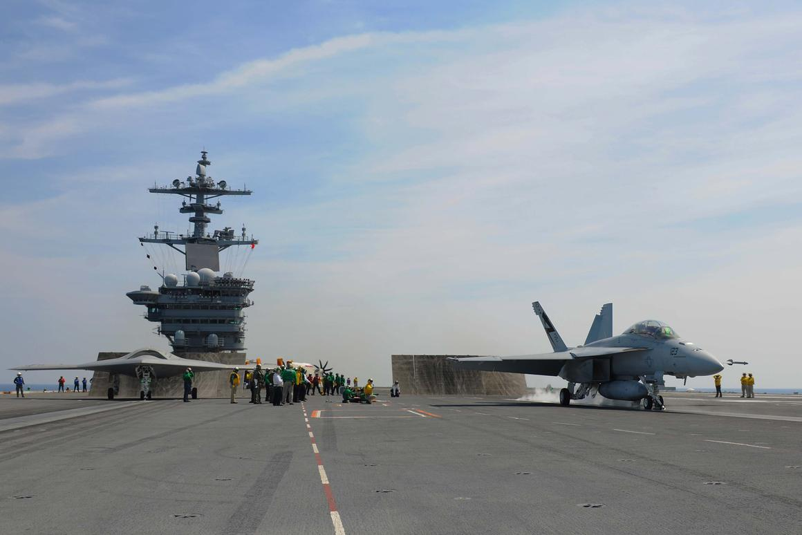 X-47B is readied for launch along side an F/A-18 Hornet (Photo: Mass Communications Specialist Seaman Apprentice Alex Millar/US Navy)