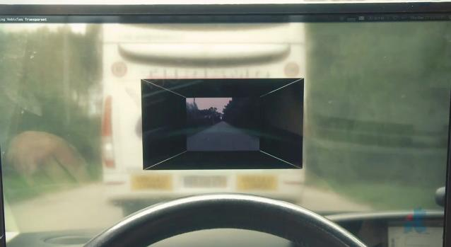 "An LCD built into the driver's windshield allows them to ""see through"" the bus that they're behind"
