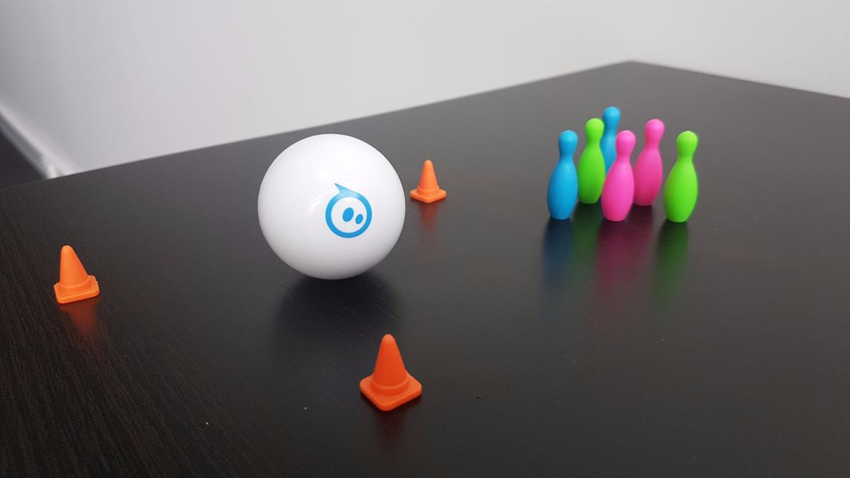 The Sphero Mini comes with aset of traffic cones and bowling pins, to navigate the ball between