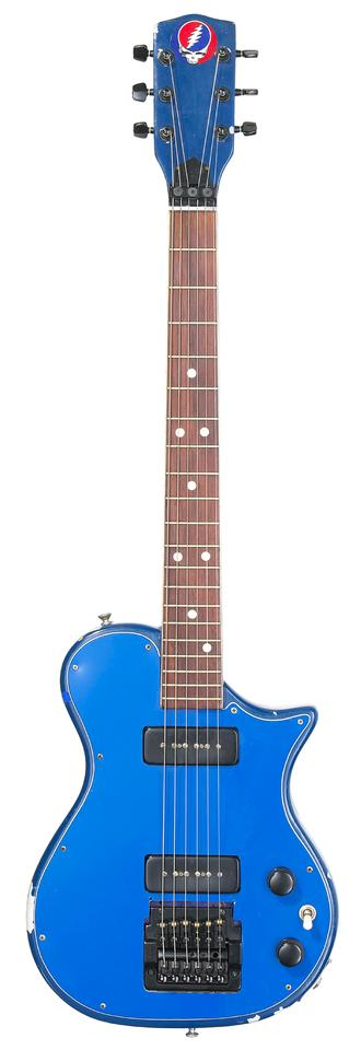 "The solid body sky blue electric that Garcia apparently called ""trainer"" - bought and modified by Garcia for the son of Grateful Dead manager, Rock Scully"