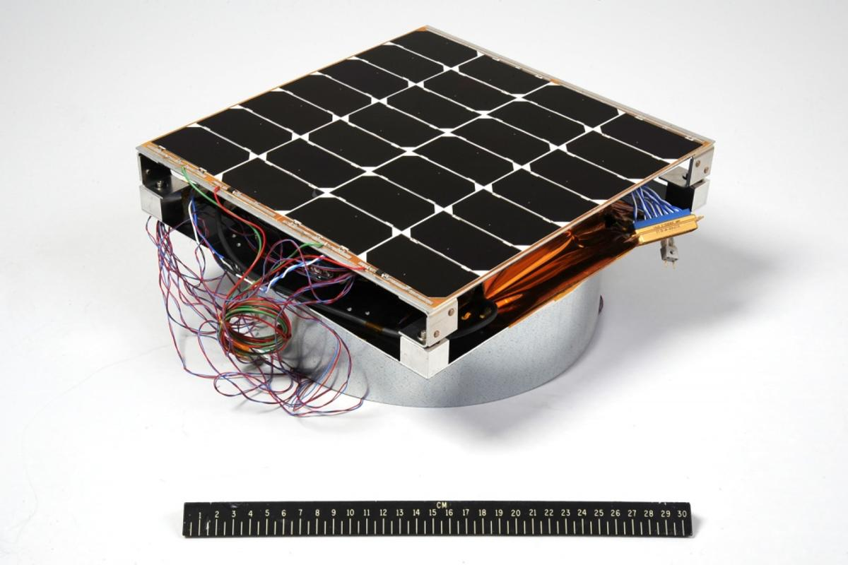 The Photovoltaic Radio-frequency Antenna Module (PRAM) that is designed to convert sunlight into microwaves for power transmission, with a 12-inch ruler for scale