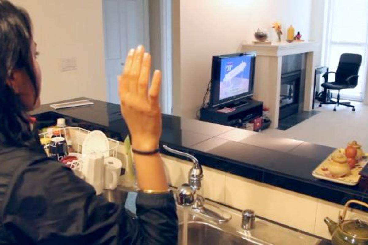 A WiSee user could control their TV using gestures, even if a wall separated them and the WiSee device