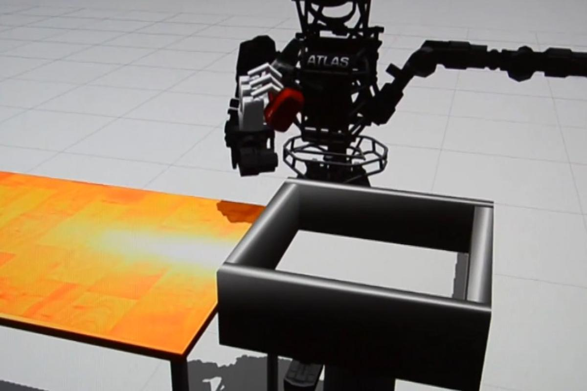 Boston Dynamics' humanoid robot ATLAS attempts to put a power drill into a bin in simulation