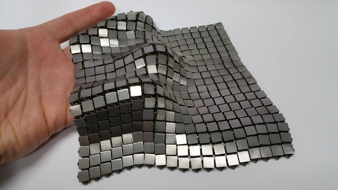 """The metallic """"space fabric"""" that was created using 3-D printing techniques that allow different functionality to be integrated into each side of the material"""