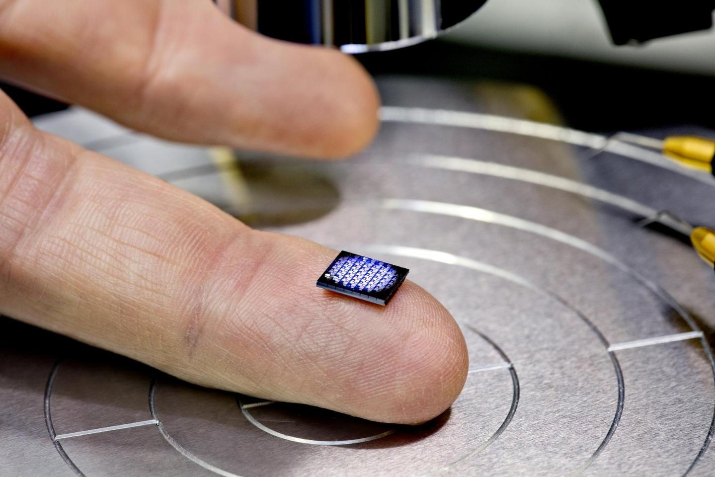 Among IBM's annual 5 in 5 list is the world's smallest computer, smaller than a grain of salt – seen here as the tiny white dot on the lefthand corner of the chip