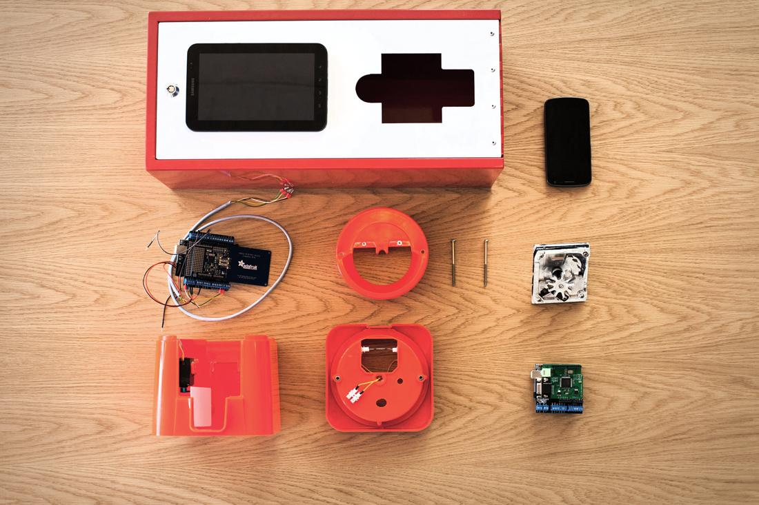 The components of the Digital Gum Machine developed by the Razor Emerging Experiences team - including a Samsung Galaxy Tab, an Adafruit NFC shield, a simple reed switch and two Arduino microcontrollers