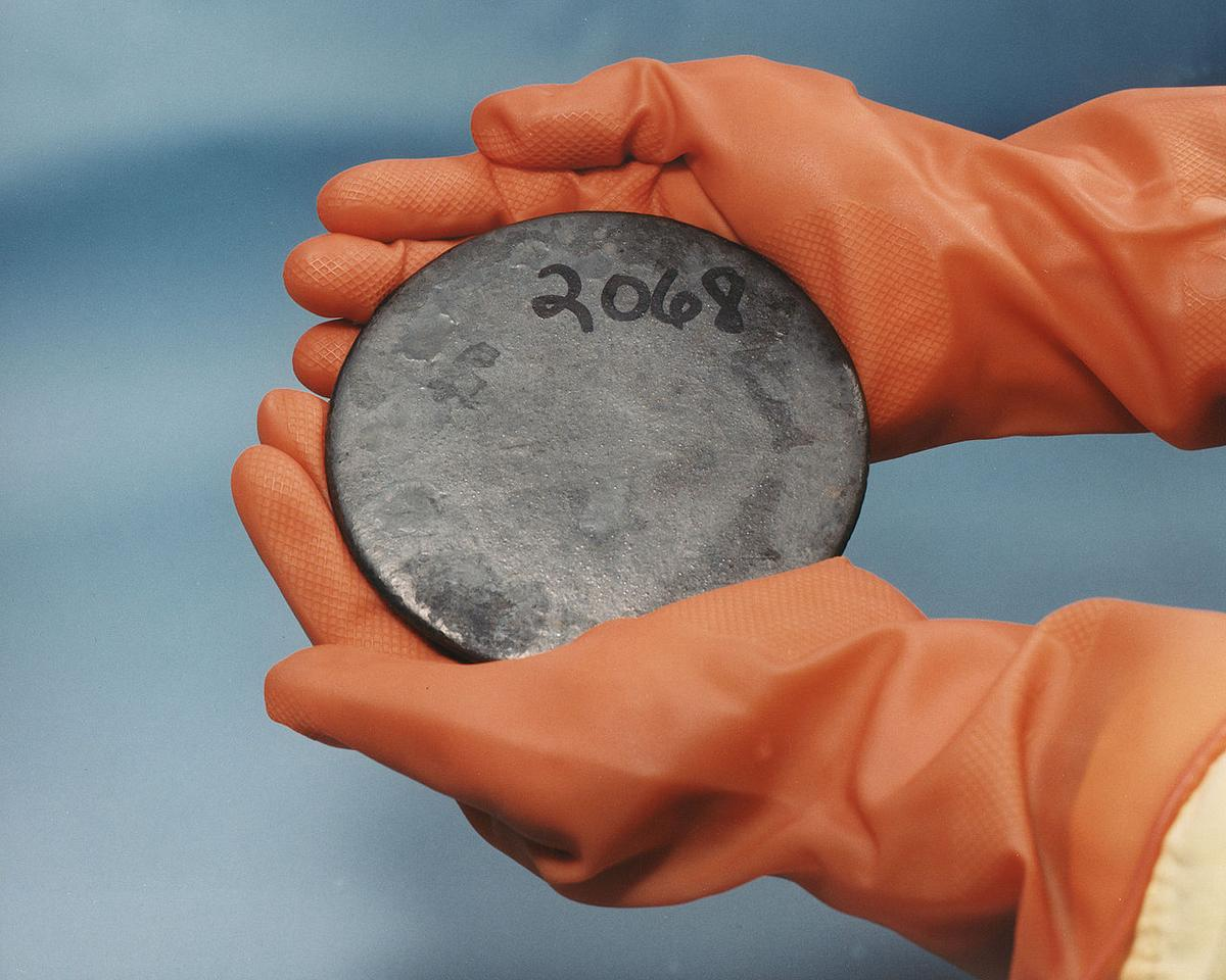 A disc of highly enriched uranium from the Y-12 National Security Complex Plant