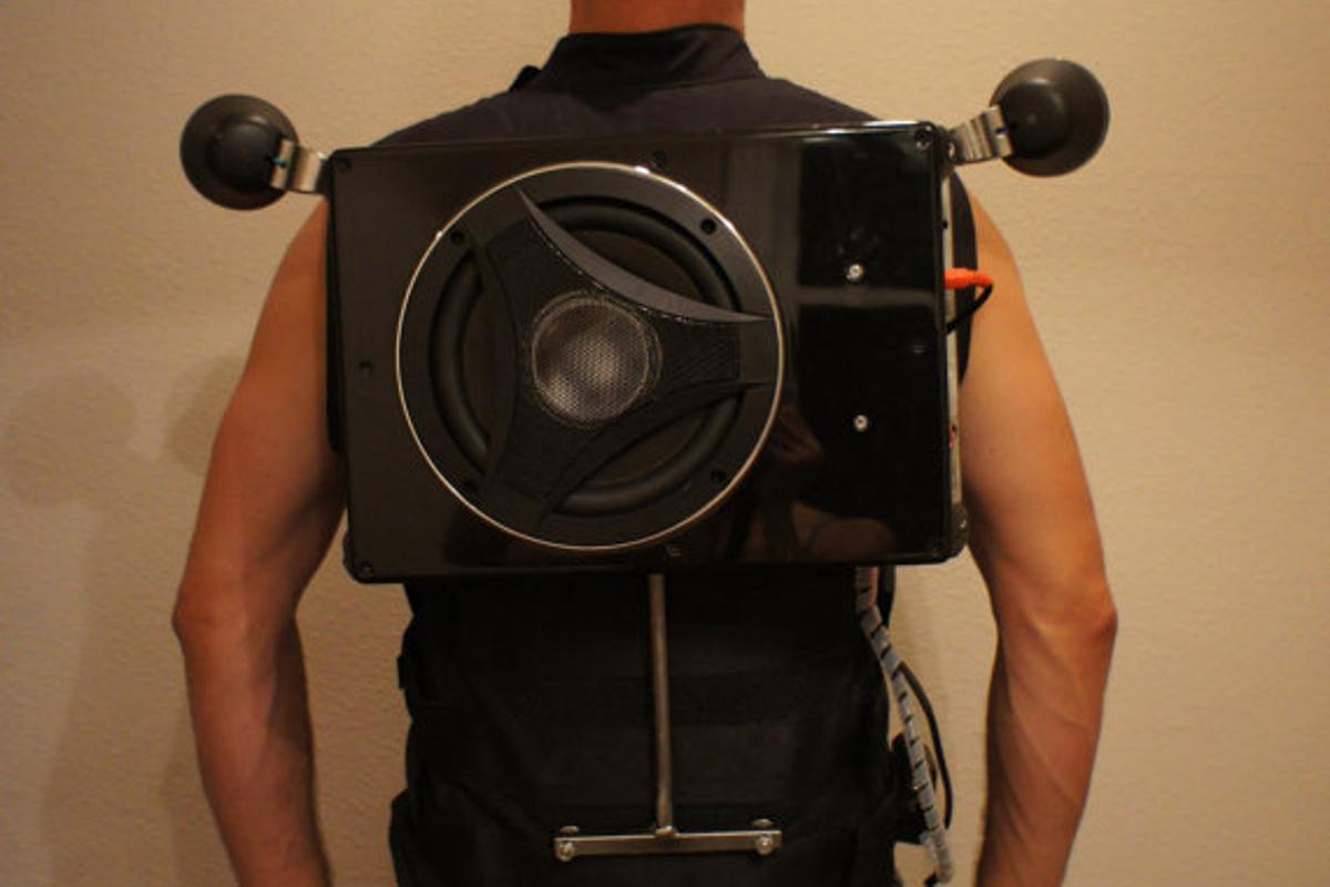 The Party Vest comes retrofitted with an 8-inch Boss audio bass 900 subwoofer, with a pair of motorcycle speakers reaching over each shoulder