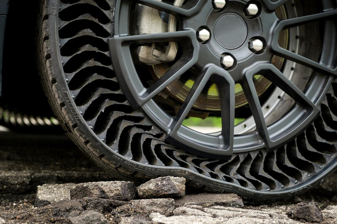 Road hazards are absorbed by the Uptis tire, eliminating about 200 million tires a year that are scrapped early due to damage