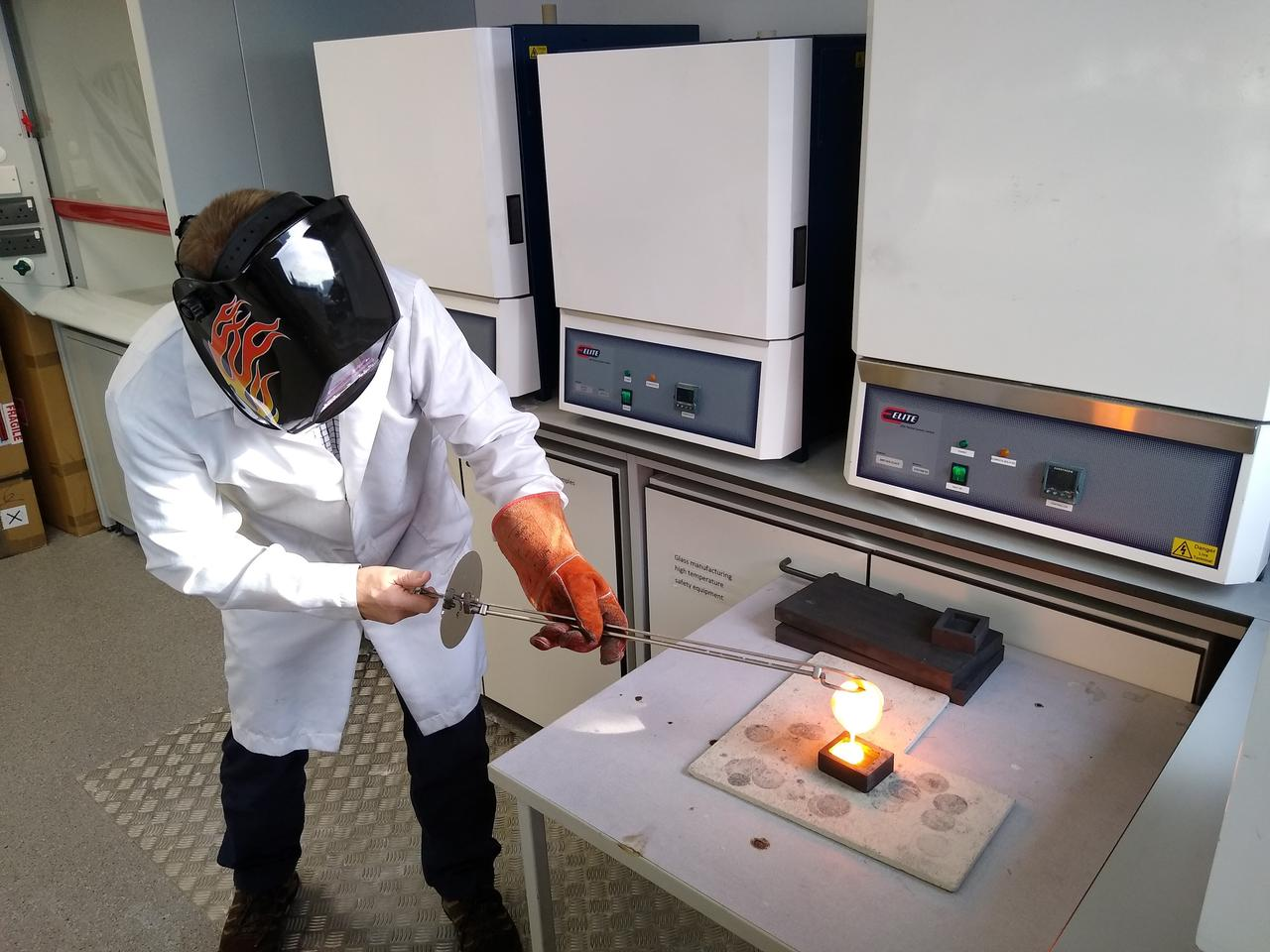 Rods of the material are formed by pouring molten glass into molds