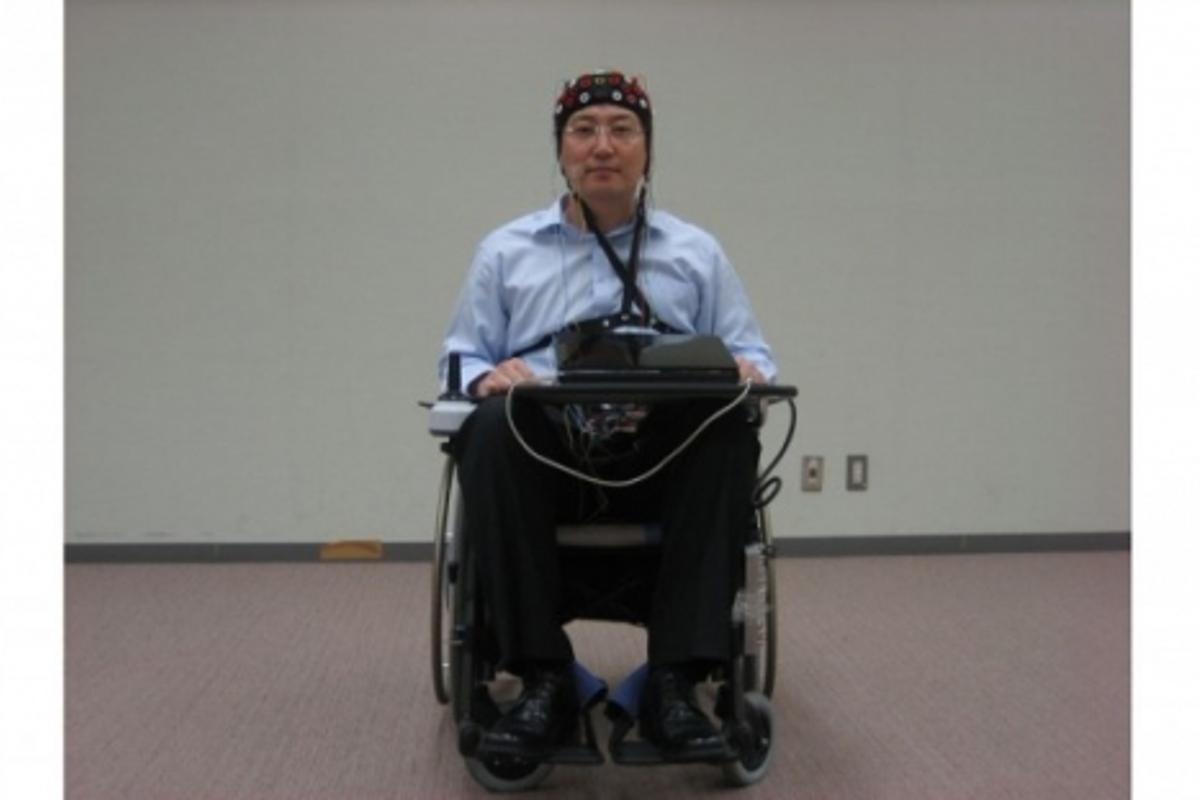The Toyota/RIKEN wheelchair - this laboratory prototype runs with the EEG detector run by a laptop (Photo: RIKEN)